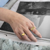 Lucky personalised signet ring by Mood Good on hand model