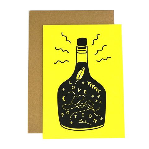 bottle of love potion black and yellow greetings card