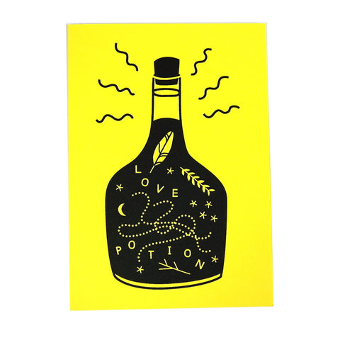 love potion bottle black and yellow greetings card