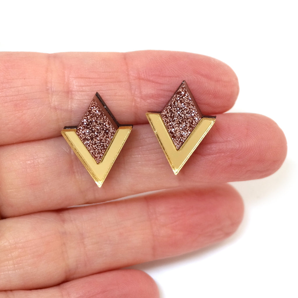Diamond Segment Stud Earrings in Gold and Rose Glitter Acrylic Hand held for size