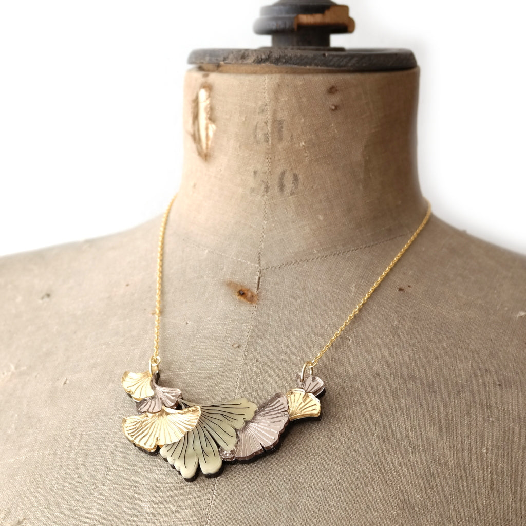 Ginkgo Leaf Small Bib Necklace in Gold and Chamomile On Mannequin
