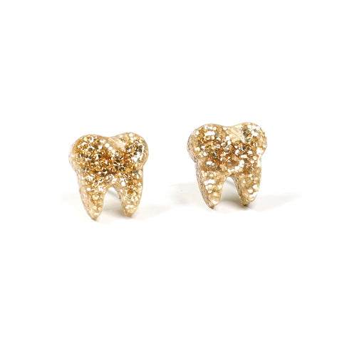 tiny acrylic gold glitter tooth earrings by finest imaginary