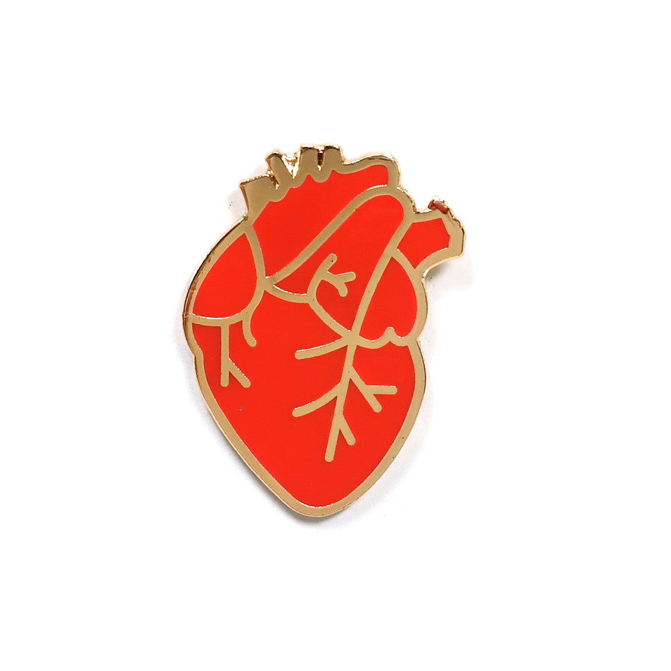 red anatomical heart enamel pin by rock cakes