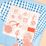 Close up of Eating, a riso print by ANO.  Detailed illustration of Japanese food.