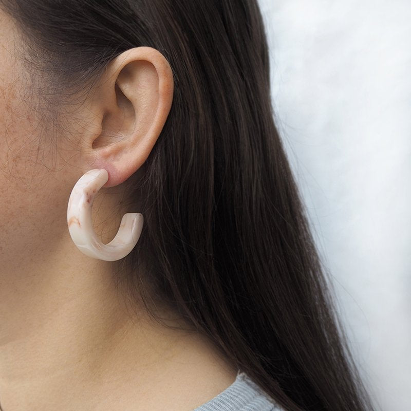 Ceto cream marble effect chunky acetate hoop earrings - worn by model