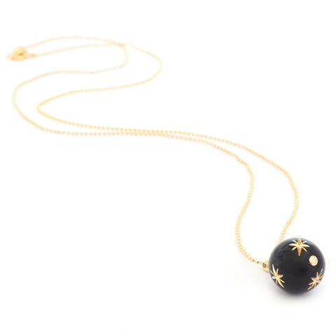 full length image of starry sky necklace black pendant with golden stars