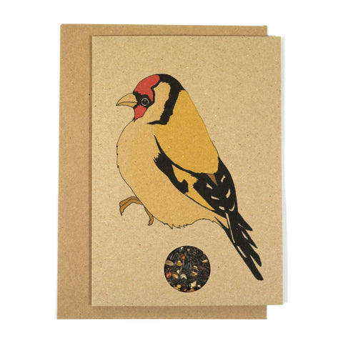Brown kraft greeting card with a printed illustration of a goldfinch and featuring a sachet of birdseed