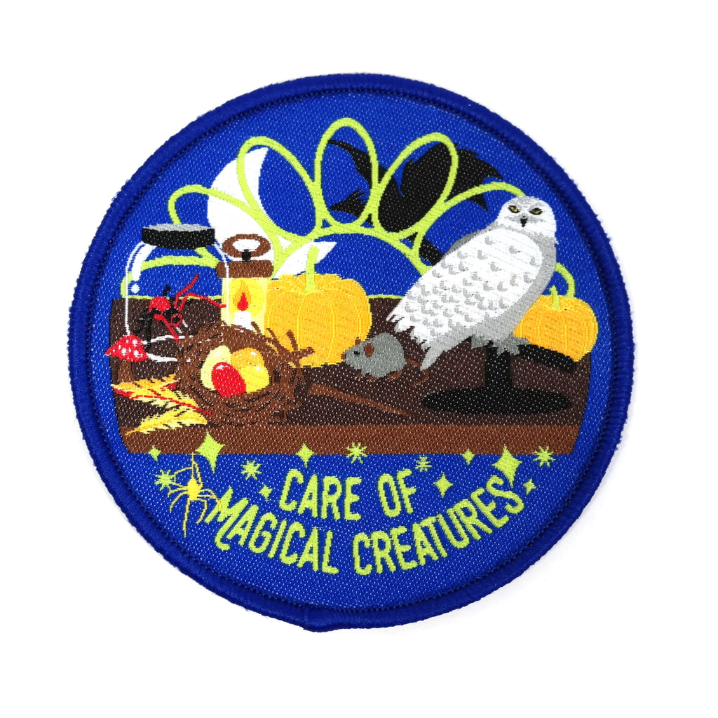 Care of Magical Creatures Harry Potter iron on embroidered patch - blue patch with magic animals on desk