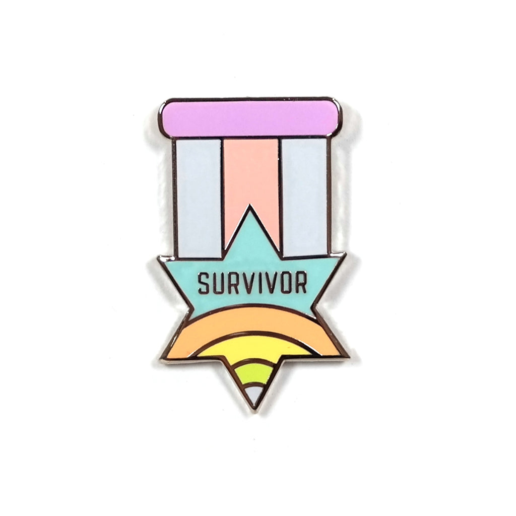 Survivor enamel pin badge by Hand Over Your Fairy Cakes. Star shaped medal style lapel pin with pastel coloured hard enamel.