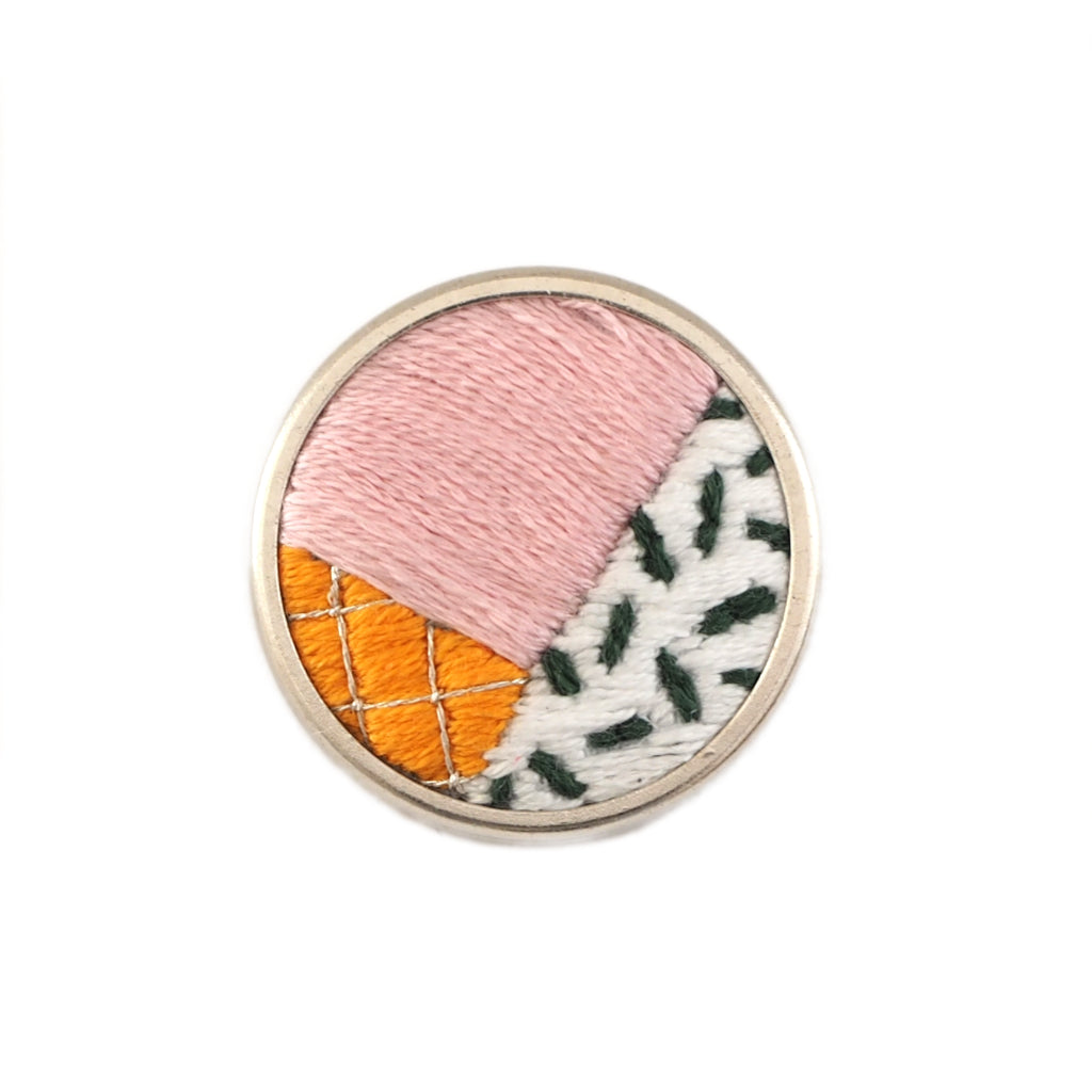 Pink, orange, black and white colourblock embroidered pin badge