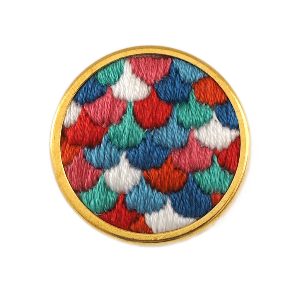 Hand embroidered brooch with multicoloured scale pattern in a round gold frame