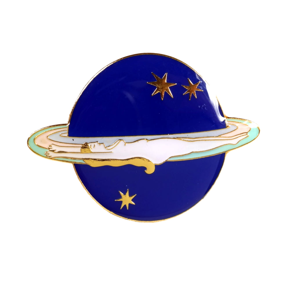 Saturn Girl nude woman on planet enamel pin. Blue and white hard enamel with gold detail.
