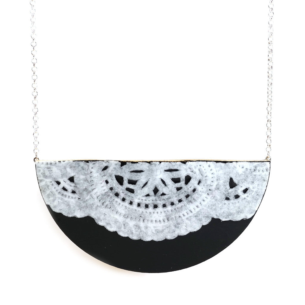 black semi circle white lace doily detail wooden necklace on silver chain by Laurafallulah