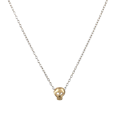 tiny gold skull necklace by michelle chang