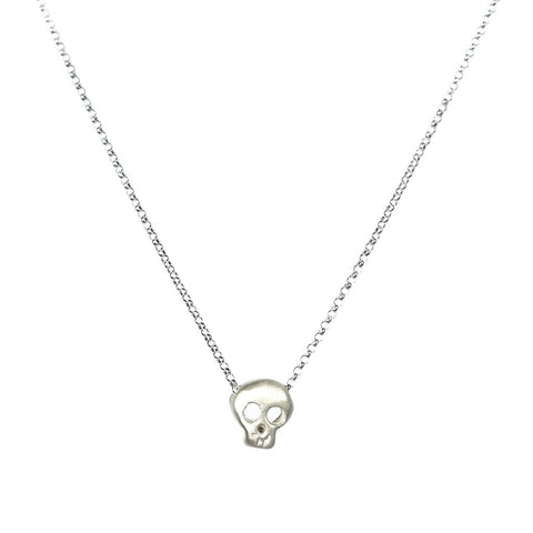 tiny sterling silver skull pendant by michelle chang
