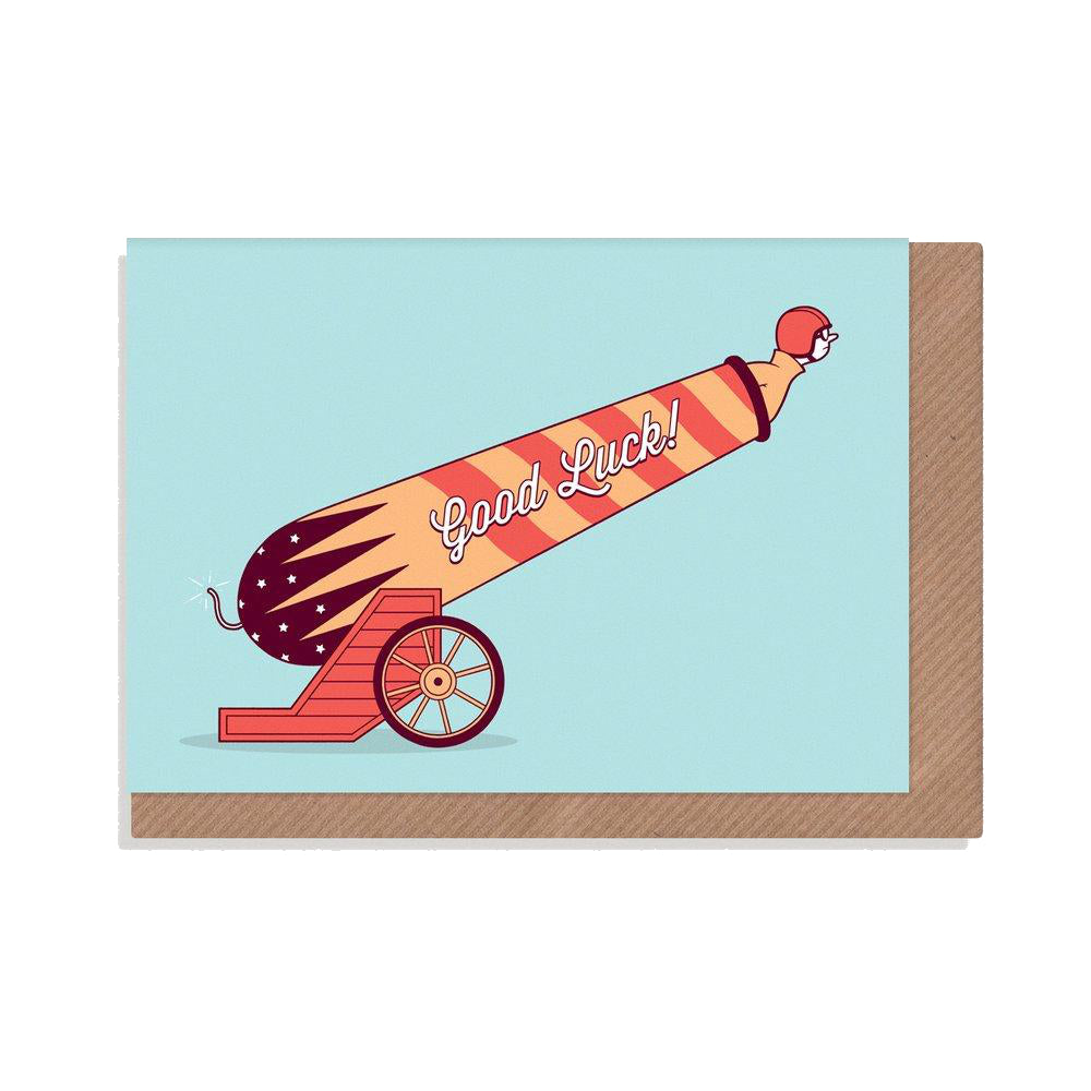 Human cannonball Good Luck Card with red and orange striped cannon on light blue background.