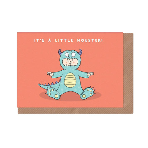It's a Little Monster! Cute new baby card with baby dressed up as scary blue monster on pink background.