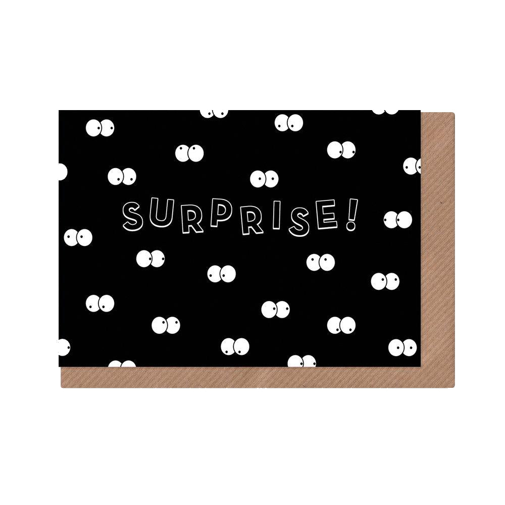 Surprise! Greeting card with black background and multiple cartoon eyes in the dark.