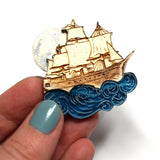 acrylic and wood moon pirate ship sailing brooch by kate rowland