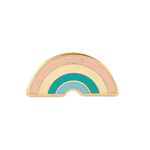 Pretty pastel and gold rainbow enamel pin with smiling face detail