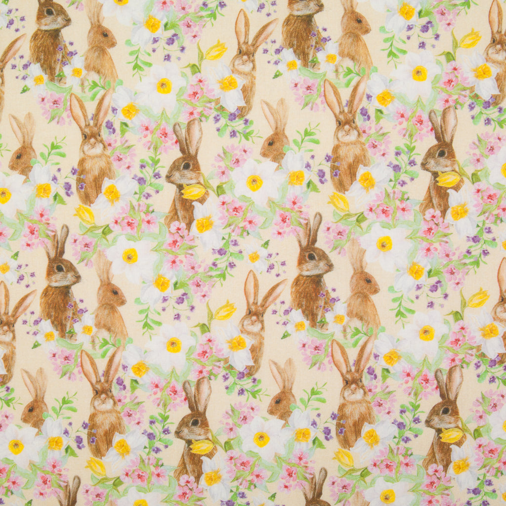 Inquisitive little bunny rabbits hiding amongst daffodils are printed on a fat quarter of cotton fabric