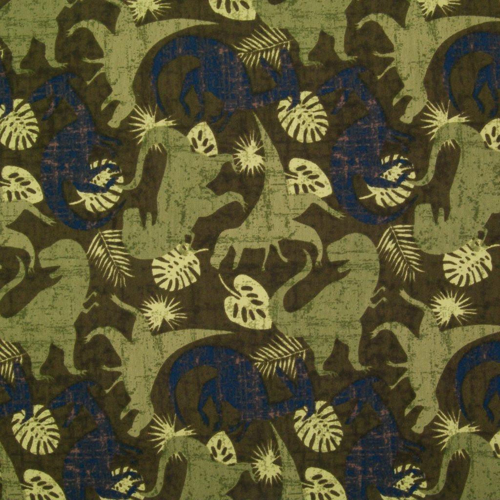 A fat quarter of cotton jersey fabric printed with green and blue dinosaurs in a jungle setting