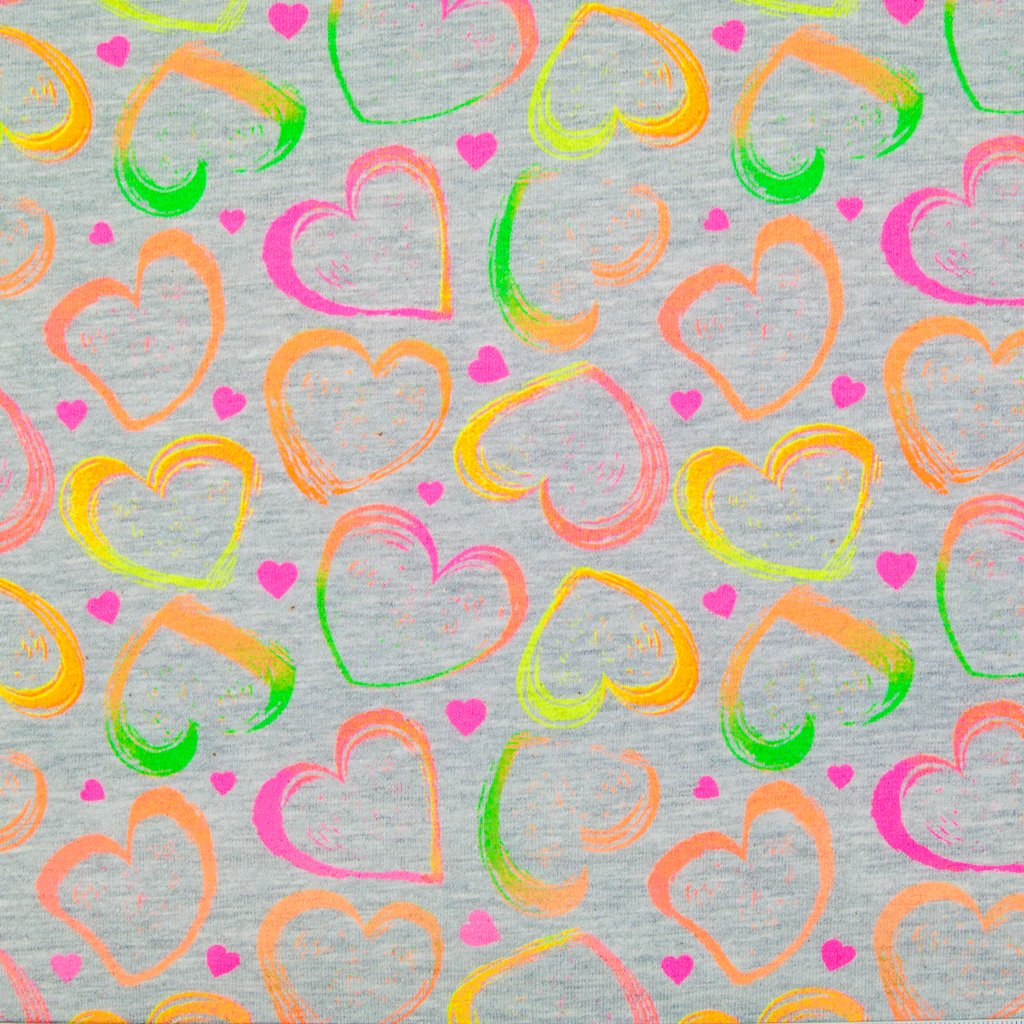Love hearts in neon pink, orange, green and yellow are printed on a grey cotton jersey fabric