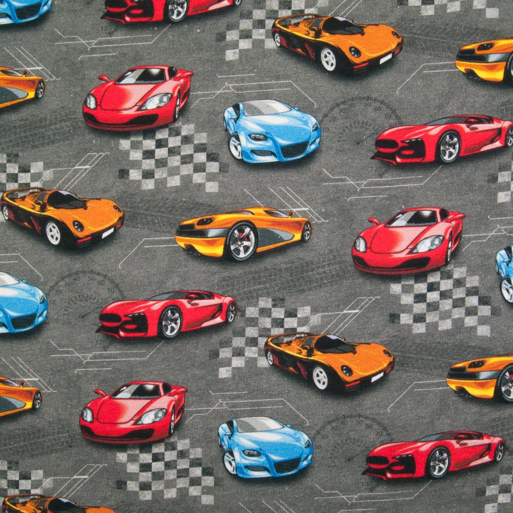 Yellow, blue and red racing cars are printed on a fat quarter of grey french terry cotton jersey fabric
