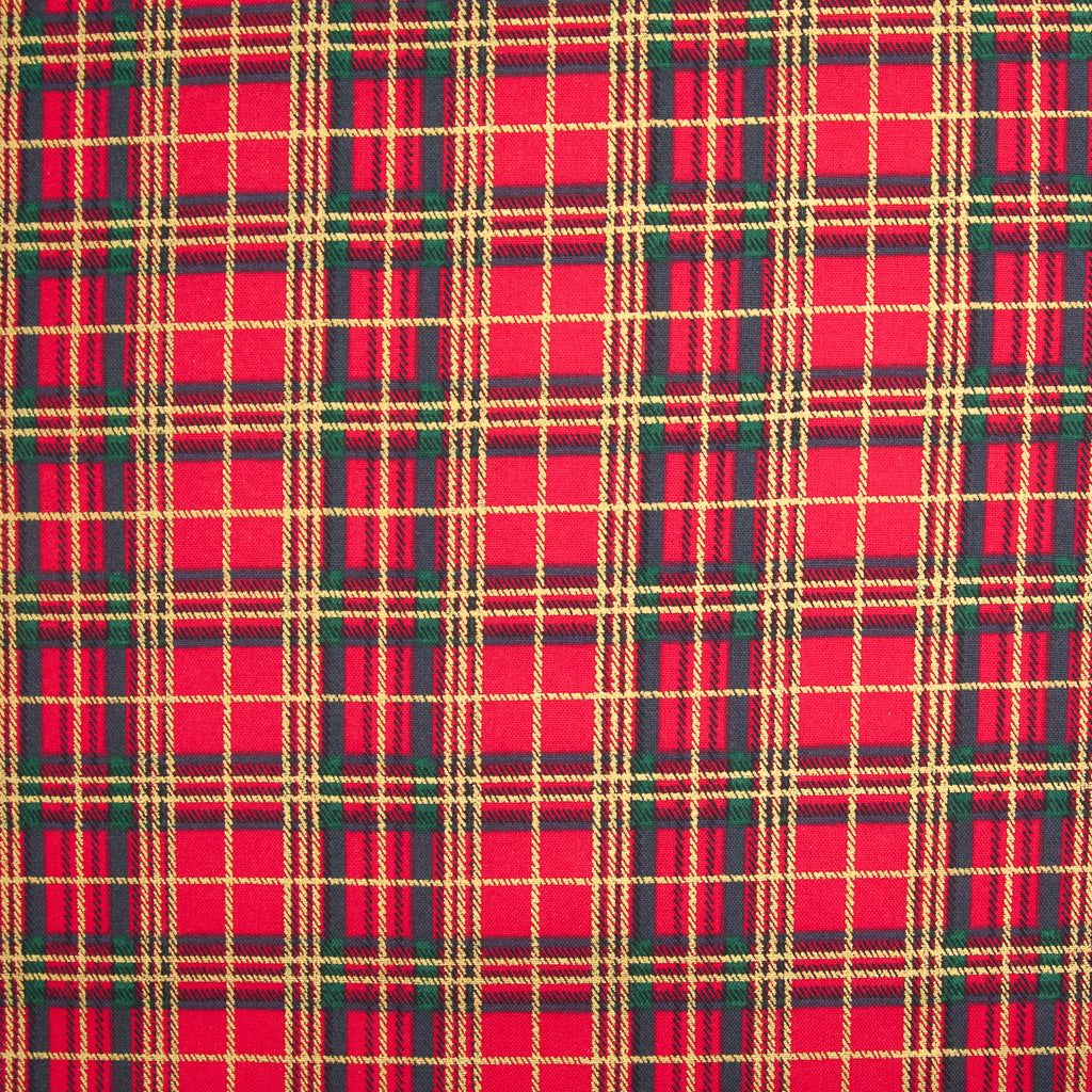 A medium sized gold lacquered and green tartan check on a red cotton fabric
