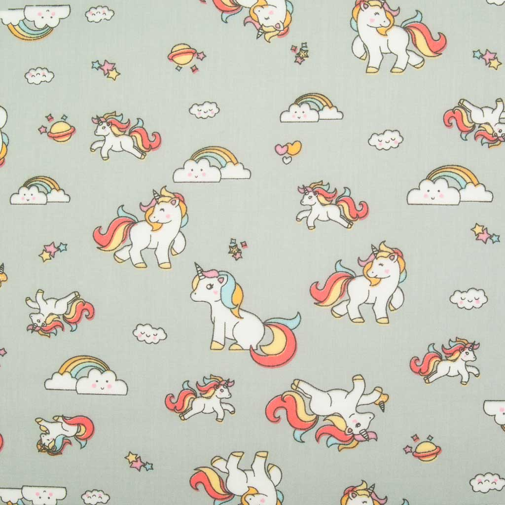 Cute white unicorns, colourful rainbows and stars are printed on a silver polycotton fabric