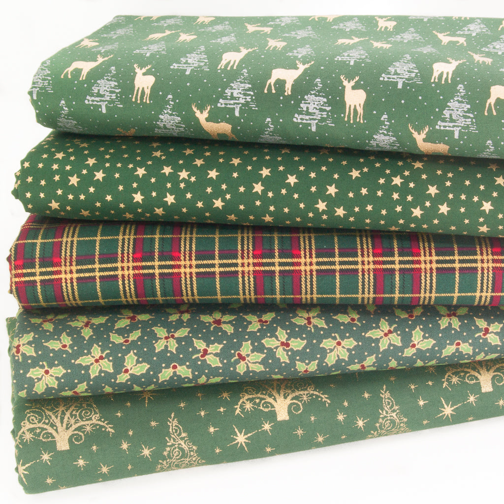 Five bottle green christmas cotton fabrics with gold lacquered images of reindeer, tossed stars, tartan check, holly and large xmas trees