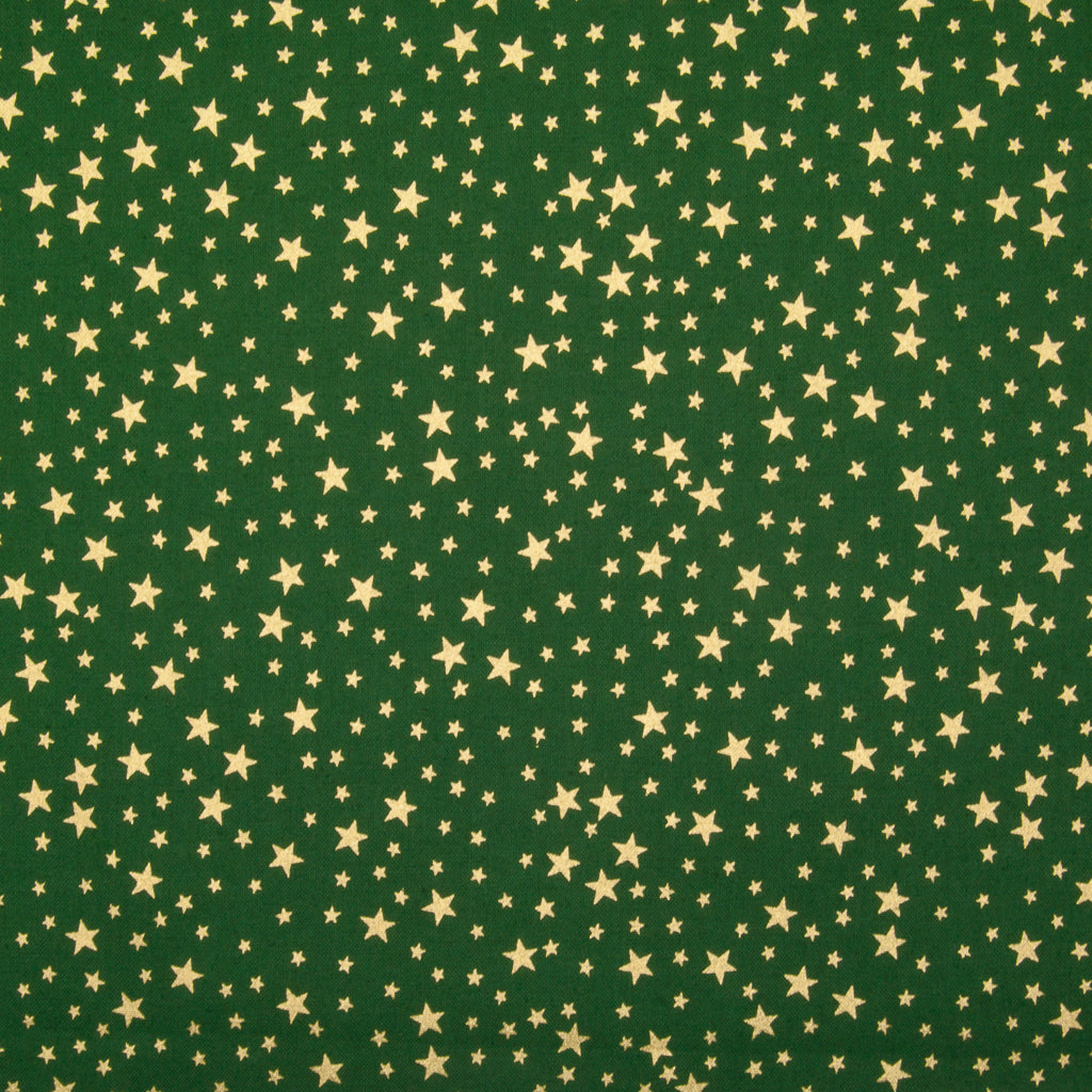 A green christmas cotton fabric featuring small metallic gold stars in a tossed pattern