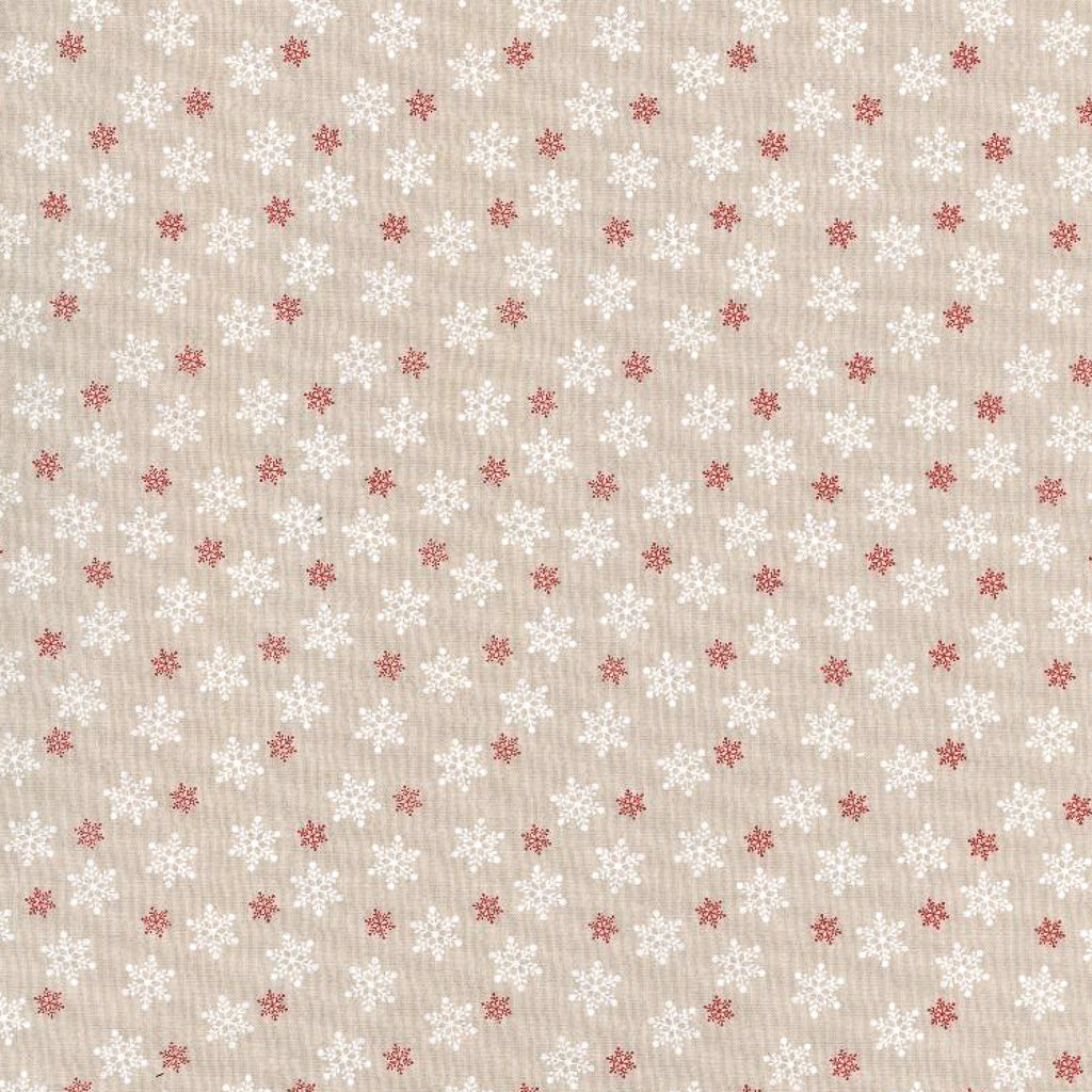 Small, white and red star shaped snowflakes on a beige christmas cotton fabric in a tossed pattern