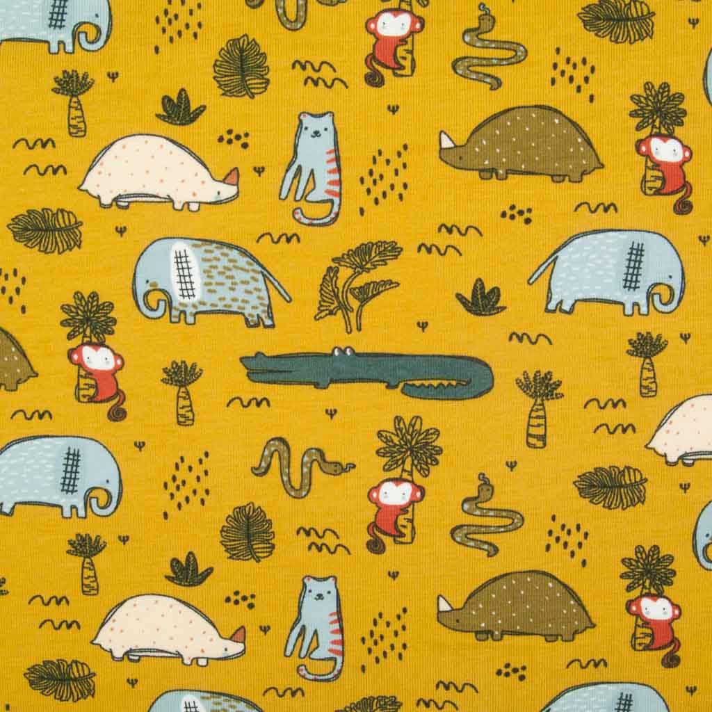 Safari animals including elephants, crocodiles, monkeys and snakes printed on an organic ochre jersey fabric
