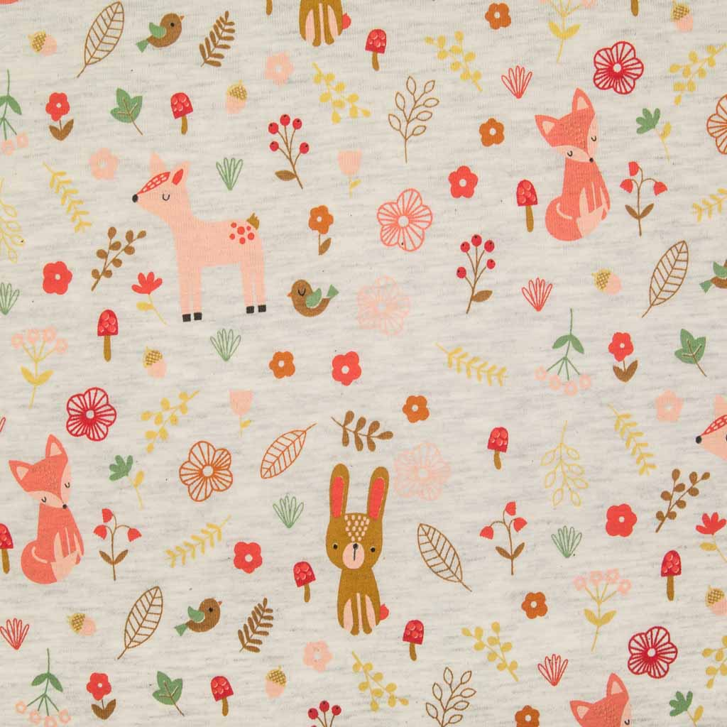 An ecru cotton jersey fabric printed with rabbits, deer, foxes and birds
