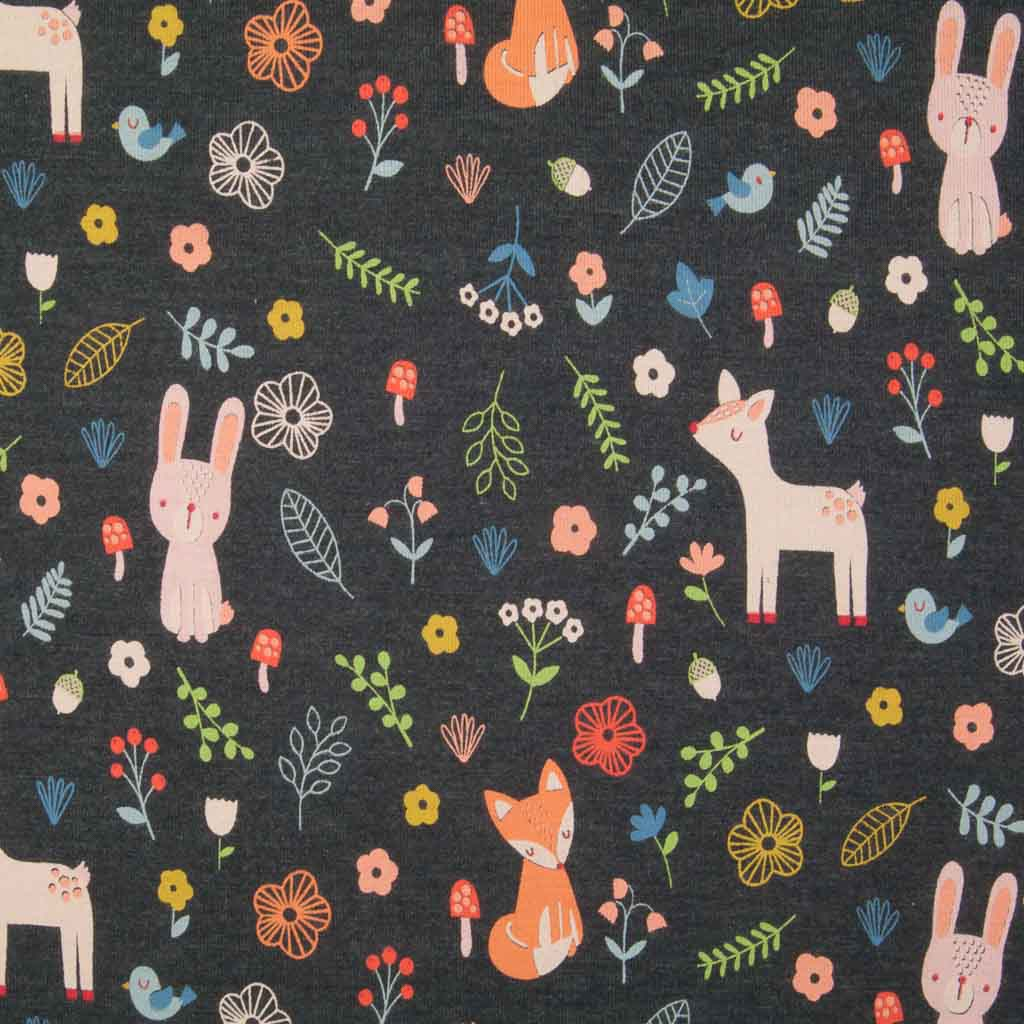 An indigo cotton jersey fabric printed with rabbits, deer, foxes and birds