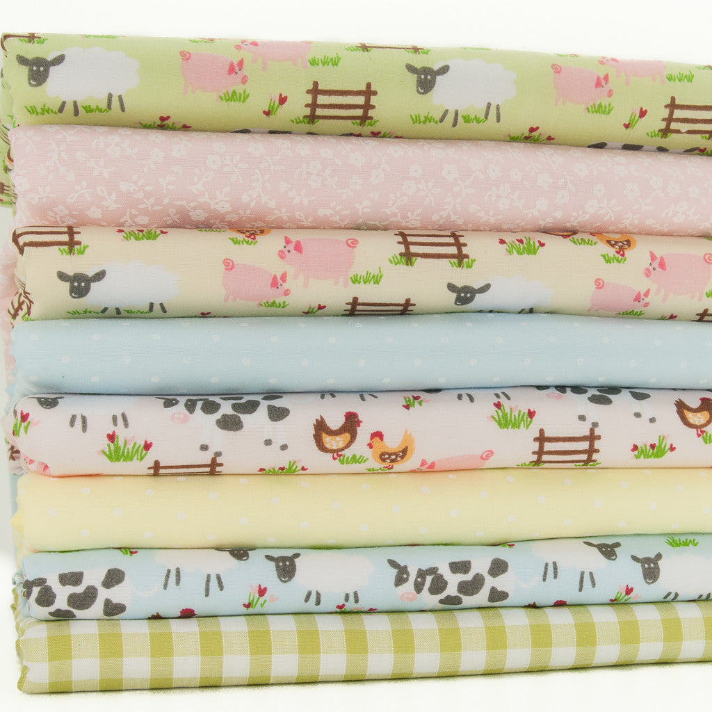 A fat quarter bundle of eight fabric prints including four farmyard designs, two spots a green gingham and a pink floral