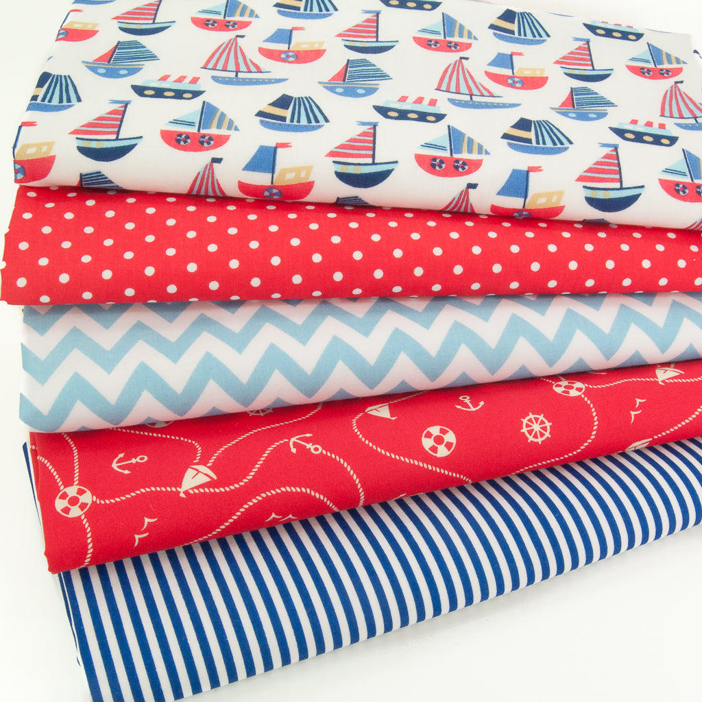 Five fat quarters of polycotton prints with red and blue stripey boats, red spots, blue stripes and a blue zig zag