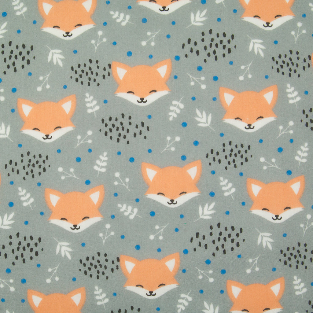 Smiling fox faces are printed on a grey polycotton fabric