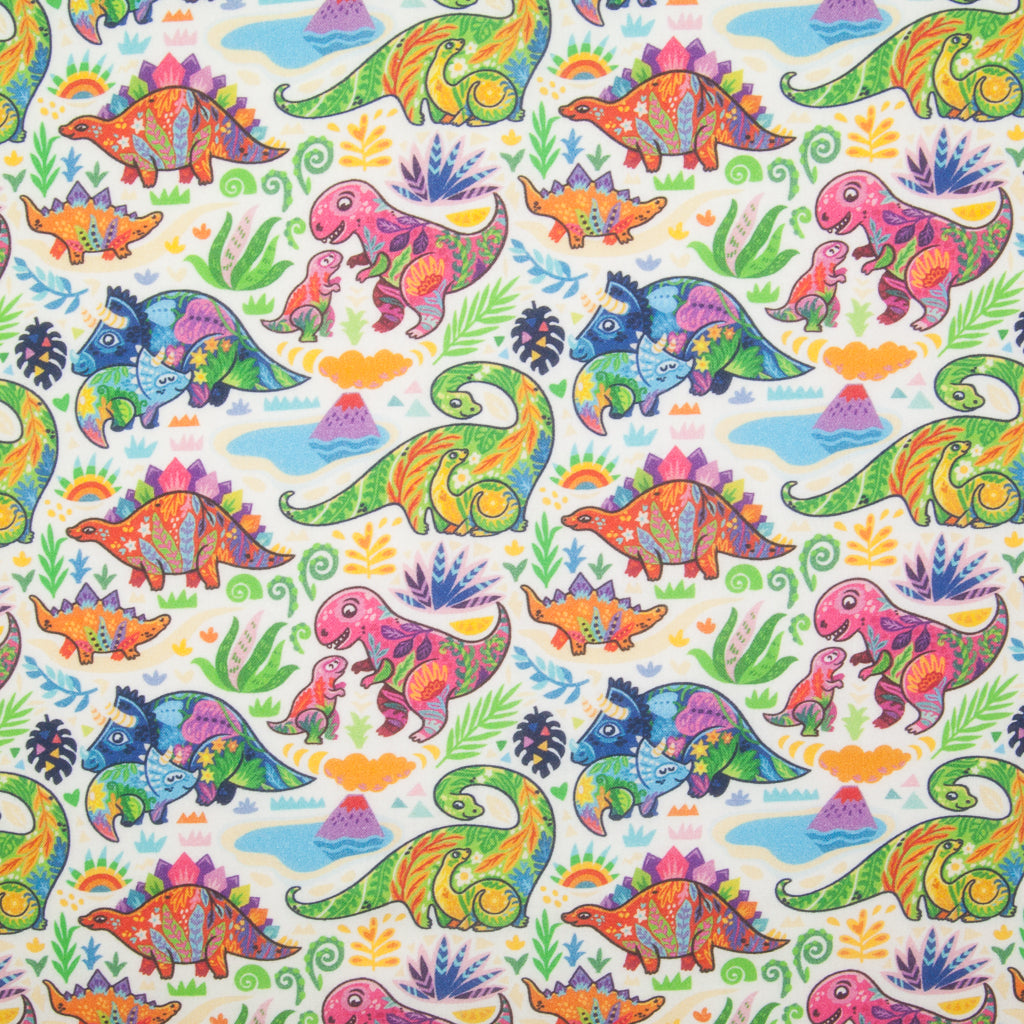 Baby dinosaurs in pink, green and blue play with their parents on this 100% cotton fabric