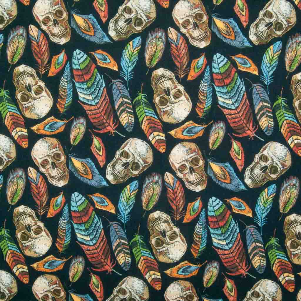 Colourful orange and green feathers with taupe skulls are printed on a 100% cotton fabric