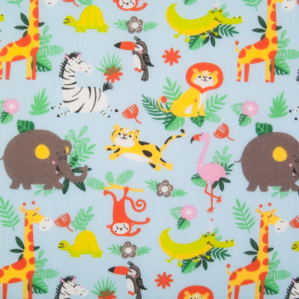 Blue polycotton fabric with a zoo print featuring elephants, zebras, flamingos in green foliage