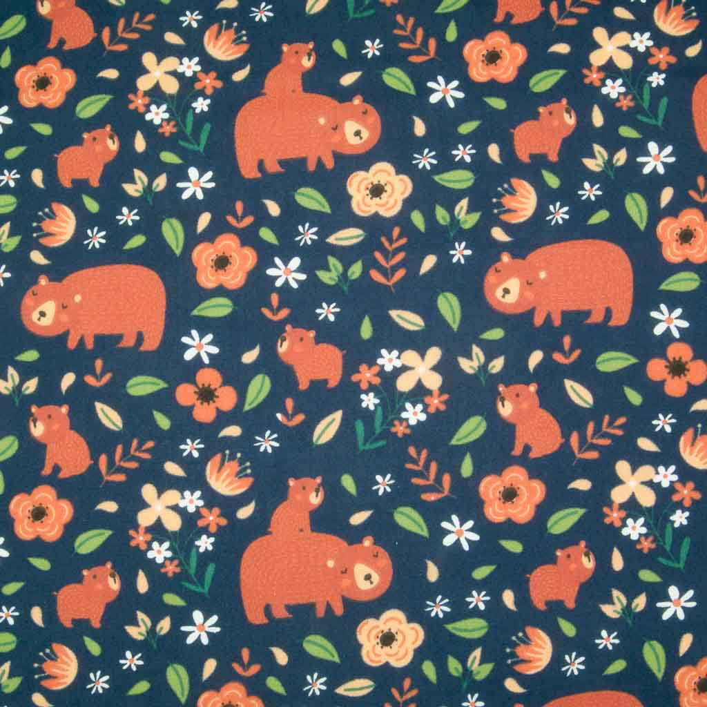 A big brown mummy bear and her baby printed with green leaves on a navy polycotton fabric