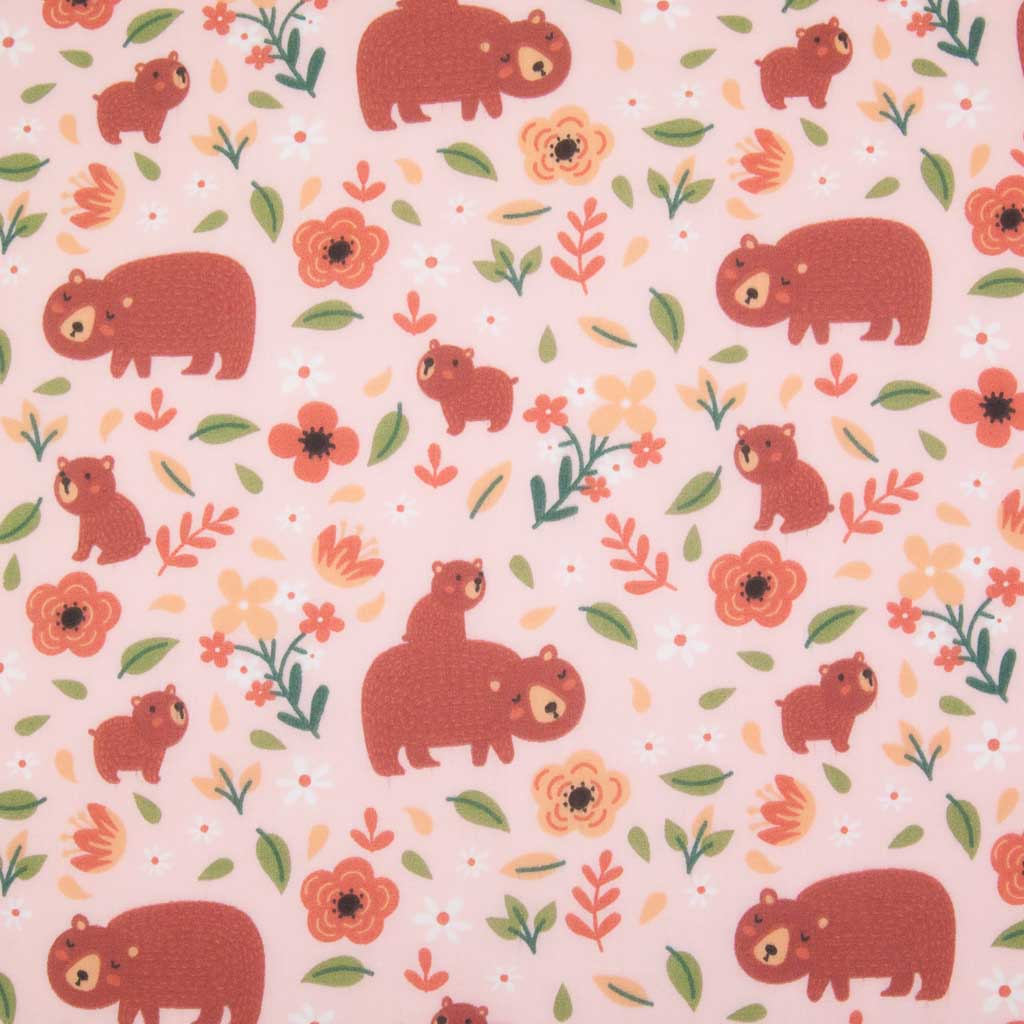 A big brown mummy bear and her baby printed with green leaves on a pink polycotton fabric