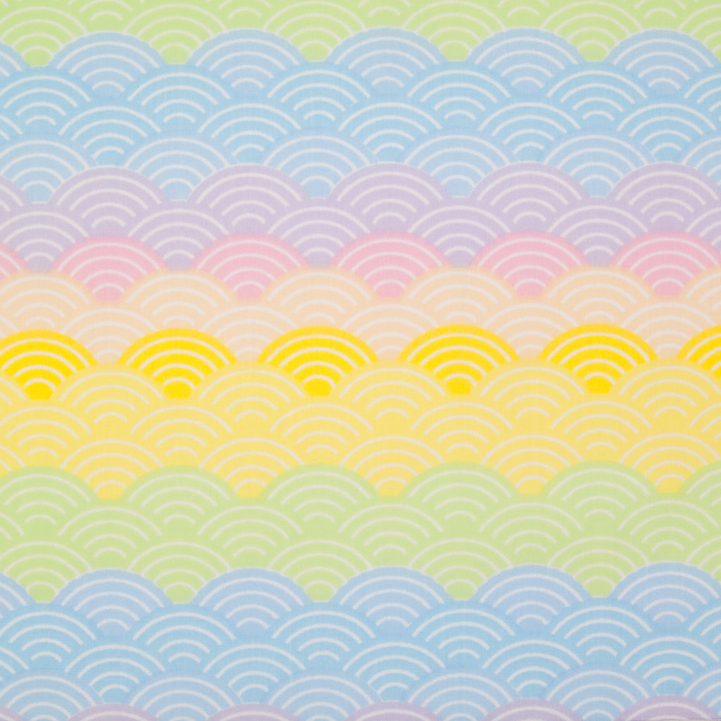 Pastel coloured rainbow arches printed on a fat quarter of polycotton fabric