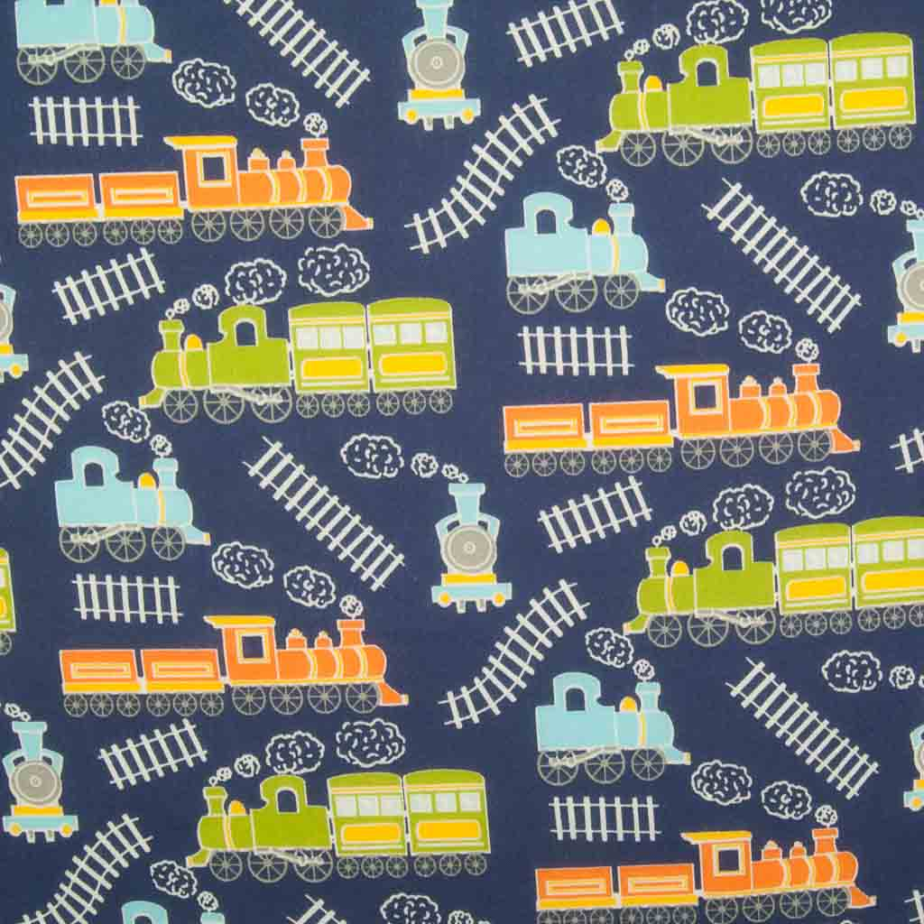 Green, blue and orange trains on train tracks are printed on a navy blue polycotton fabric