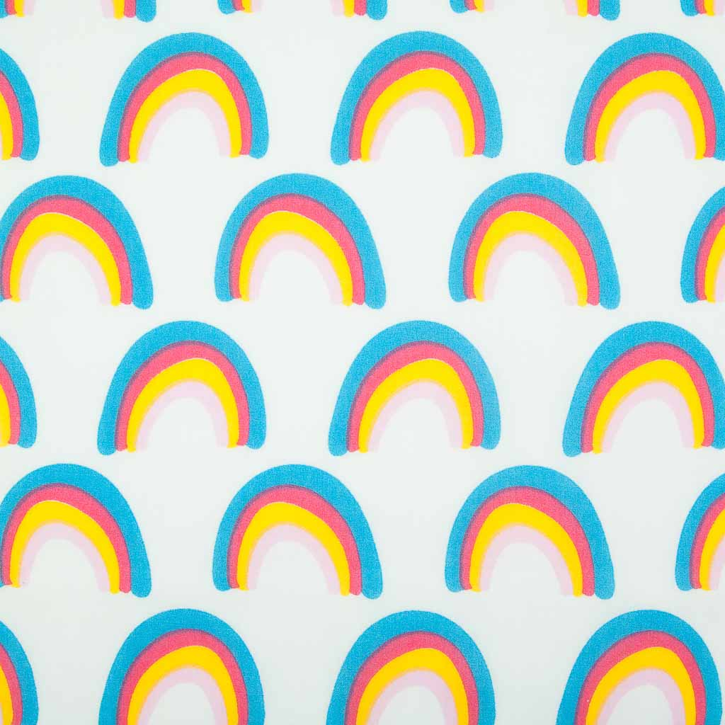 Rainbows in red, blue and yellow stripes printed on a white polycotton fabric