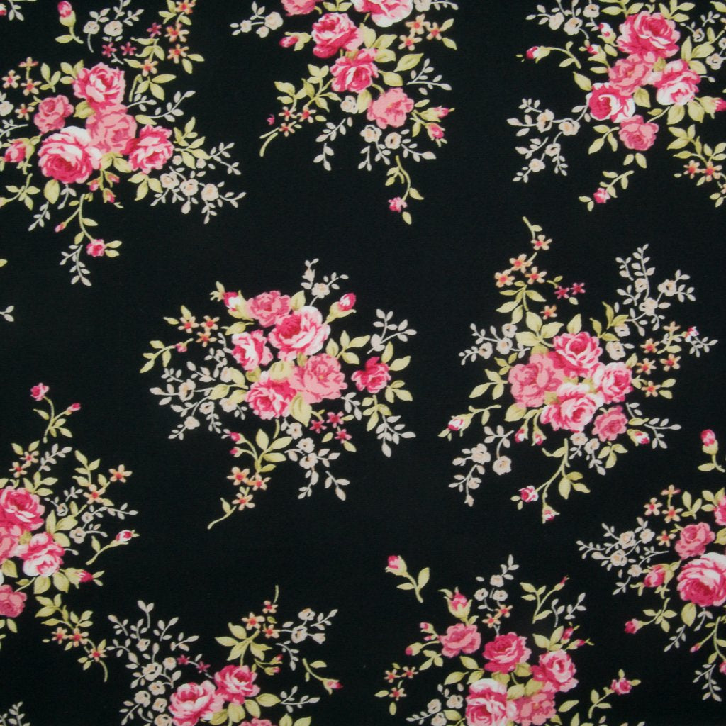 A fat quarter of small bouquets of pink roses on a black Rose & Hubble cotton poplin fabric