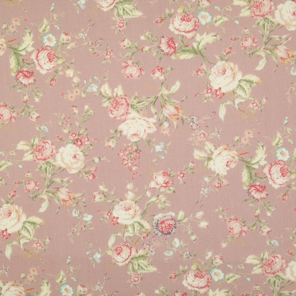 A floral pattern of pink and pale roses on a fat quarter of Rose & Hubble cotton poplin fabric