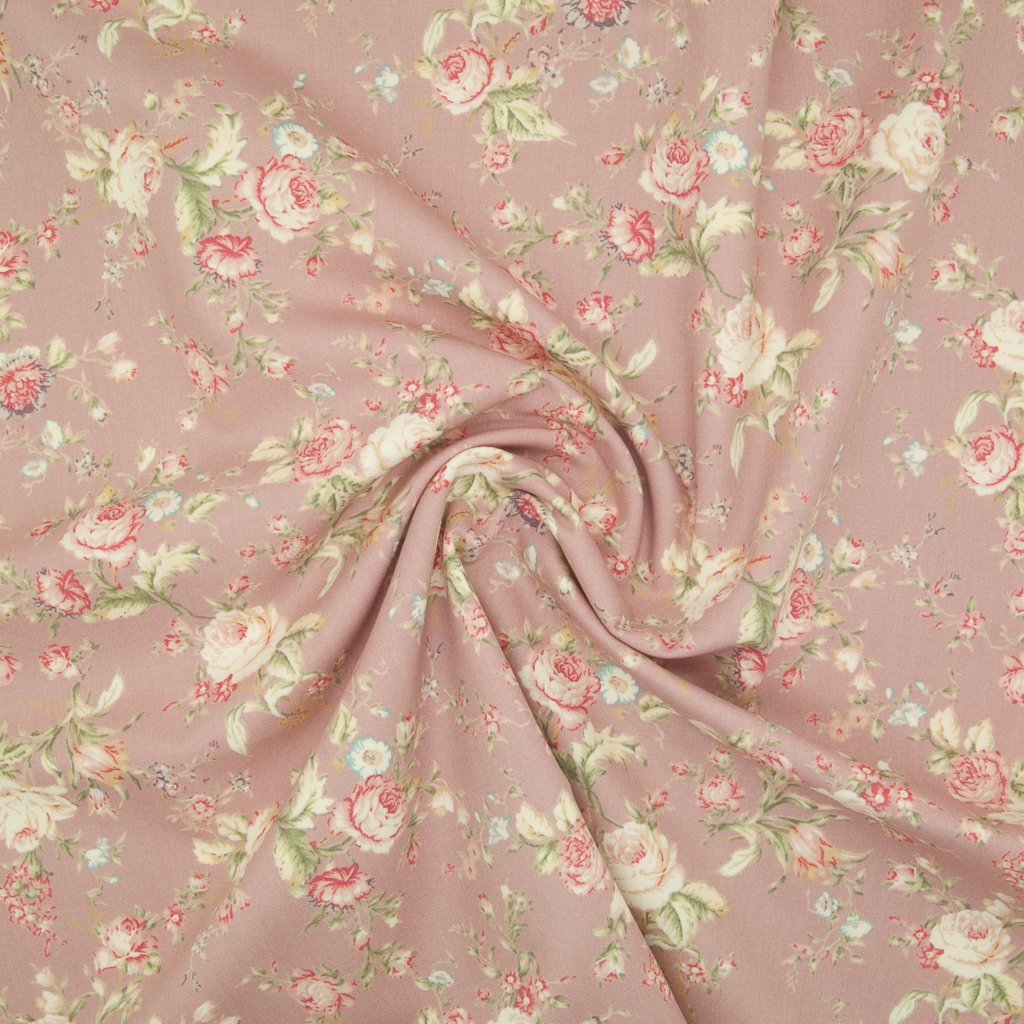 A floral pattern of pink and pale roses on a  cotton poplin fabric with a swirl in the middle for drape perspective